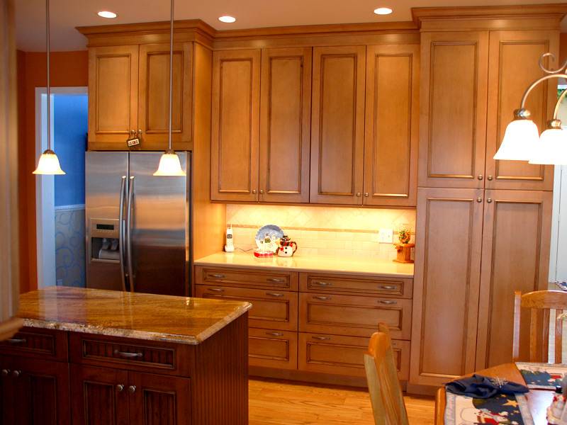 cherry wood cabinets and black granite countertops